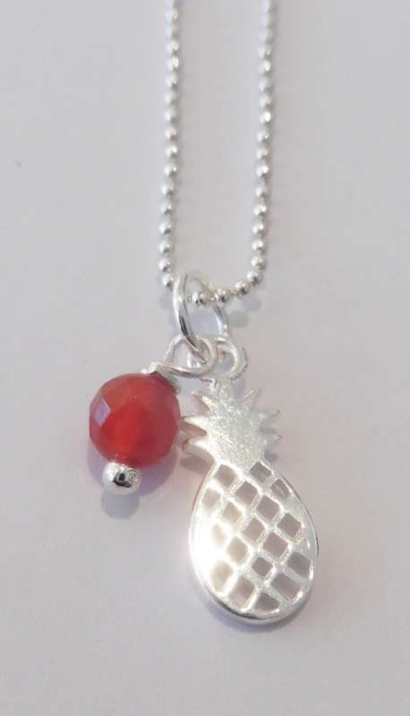 Silver necklace with pineapple charm and carnelian