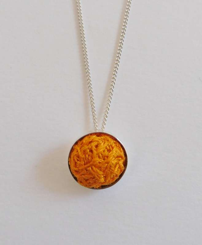 Orange stitched gem pendant with 16-inch chain