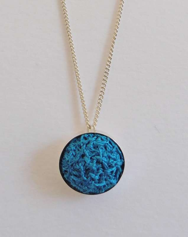 Turquoise stitched gem pendant with 16-inch chain