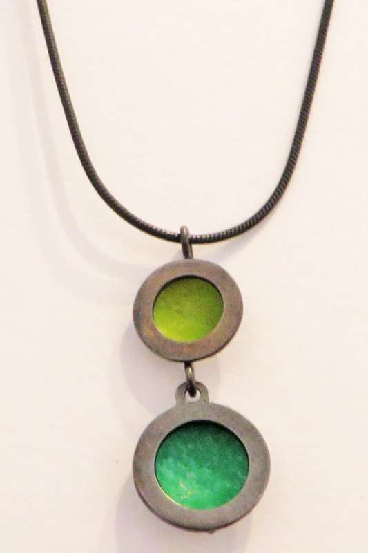 Oxidised silver and green double circle necklace