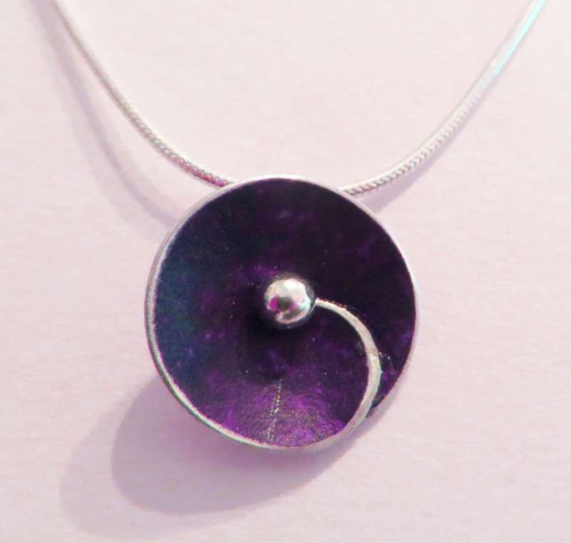Purple spiral disc necklace