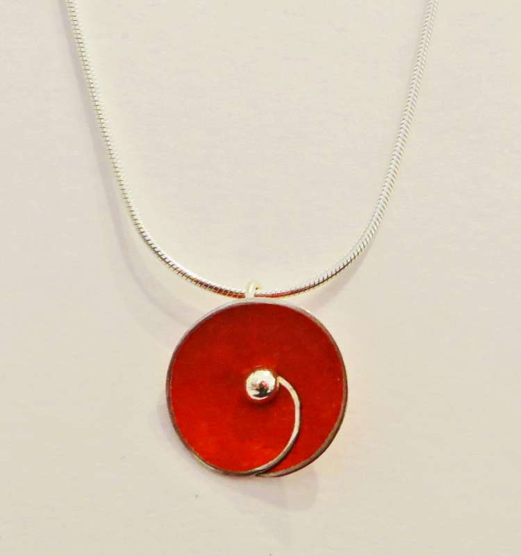 Red spiral disc necklace
