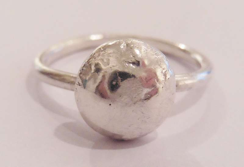 Silver ring with textured node