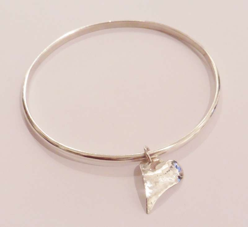 Hallmarked silver bracelet with heart charm