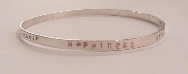 Bracelet embossed with Love Friendship Happiness Health