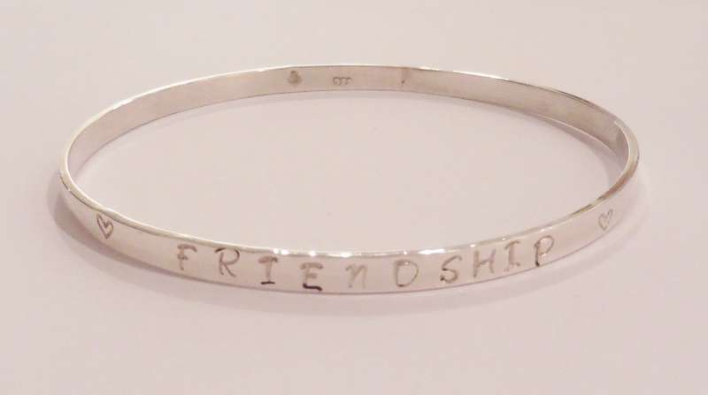 Silver bracelet embossed with Friendship
